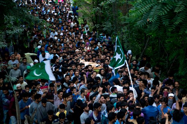 Kashmiri villagers carry the body of Burhan Wani, chief of operations of Indian Kashmir's largest rebel...