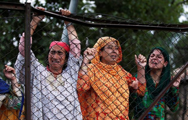 Kashmiri women mourn the death of Burhan Wani, a separatist militant leader, during his funeral in Tral,...