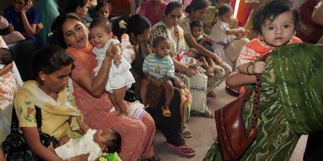 Mothers wait with their children to administer DPT (Diphtheria, pertussis and tetanus) vaccine to them,...
