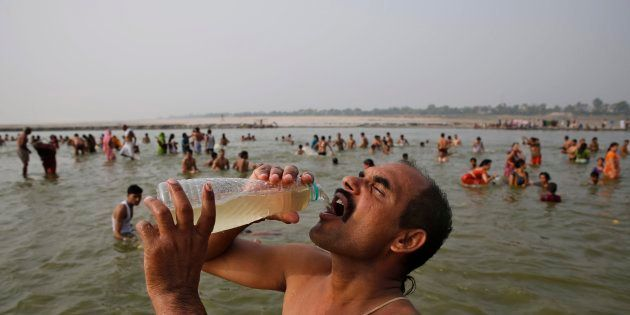 A man drinks water from the Ganga during the Ganga Dussehra festival in Allahabad, June 8, 2014. (AP...