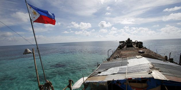 A Philippine flag flutters from BRP Sierra Madre, a dilapidated Philippine Navy ship that has been aground...