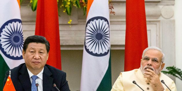 Narendra Modi, India's prime minister, right, and Xi Jinping, China's president, attend a meeting to...