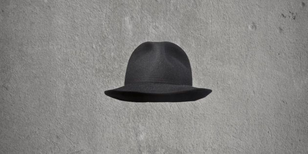 invisible businessman with hat on gray
