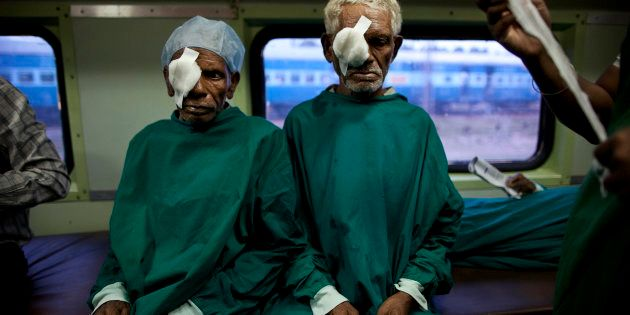 In this July 18, 2011 photo, Indian tribal villagers are bandaged after undergoing cataract surgeries...