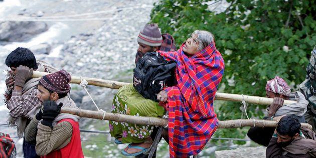 File photo of Kashmiri Muslim nomads carrying a Hindu pilgrim on a palanquin to the holy cave of Lord...