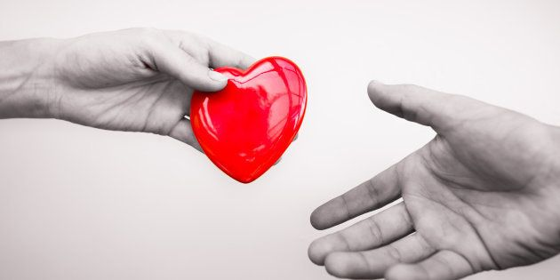 Hand giving a heart to