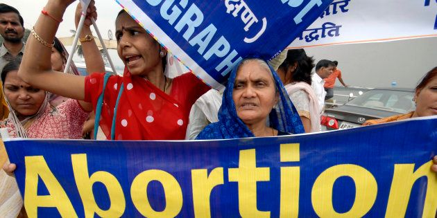 Women attend a rally against abortion in the southern Indian city of Hyderabad October 2, 2008. REUTERS/Krishnendu...