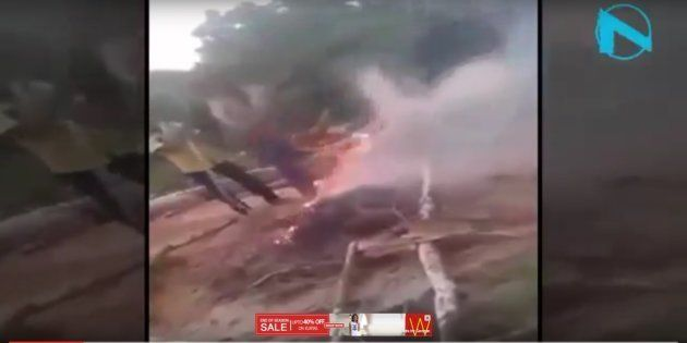 In the video grab, the boys are seen burning alive three