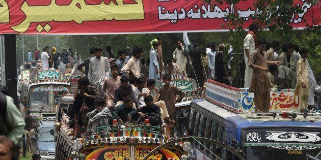 Pakistani supporters of the banned organisation Jamaat-ud-Dawa (JuD) start a march from Lahore to Islamabad...