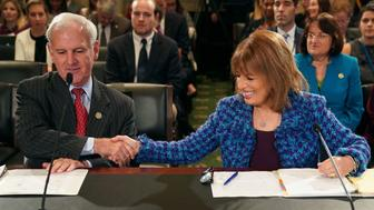 WASHINGTON, DC - NOVEMBER 14:  Rep. Bradley Byrne (R-AL) (L) and Rep. Jackie Speier (D-CA) prepare to testify before the House Administration Committee in the Longworth House Office Building on Capitol Hill November 14, 2017 in Washington, DC. In the wake of recent high-profile accusations of sexual assult and harassment by powerful people in politics, publishing, journalism, the arits and other areas, the committee recieved testimony about the need for manditory education and increased compliance to prevent sexual harassment in the Congressional workplace.  (Photo by Chip Somodevilla/Getty Images)