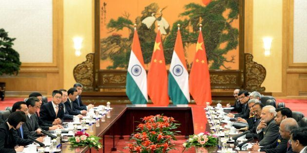 Indian Prime Minister Narendra Modi (4th R) talks with Chinese Premier Li Keqiang (2nd L) during their...