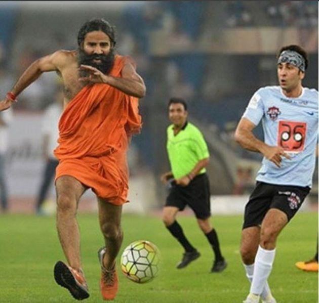 Baba Ramdev plays football with Bollywood actor Ranbir