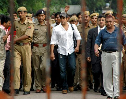 Bollywood actor Salman Khan is surrounded by police personnel as he walks out of a jail in Jodhpur.