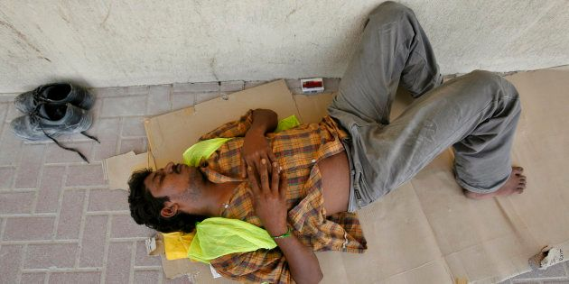 An Indian worker gets some rest during a very hot summer in Dubai, United Arab Emirates September 3,...
