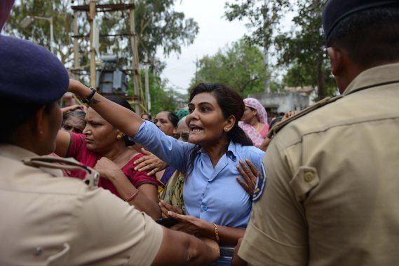 A Dalit tries to barge inside a police station to free supporters who were detained by police for damaging...