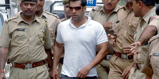 Bollywood actor Salman Khan is surrounded by police personnel on his way to the court in Jodhpur.
