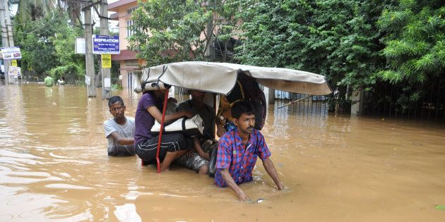 Indian residents navigate floodwaters in the Anilnagar area of