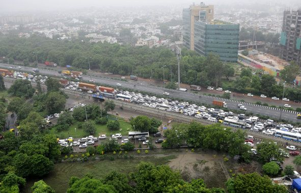 A traffic jam at Signature Tower Chowk, NH8 due to heavy rainfall on 29 July, 2016. Gurgaon Police and...