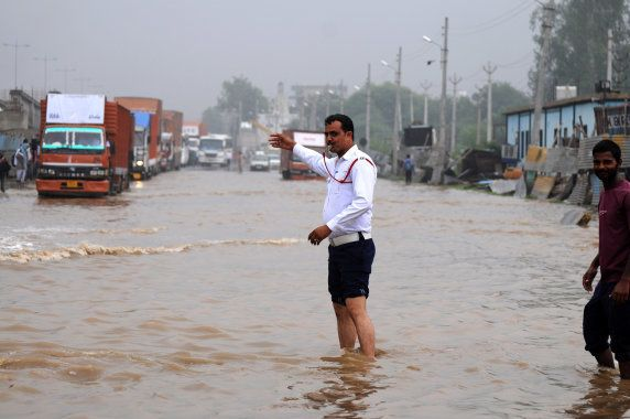 Hero Honda chowk in Gurgaon was submerged in four feet-deep water, causing commuters to be stuck in traffic...