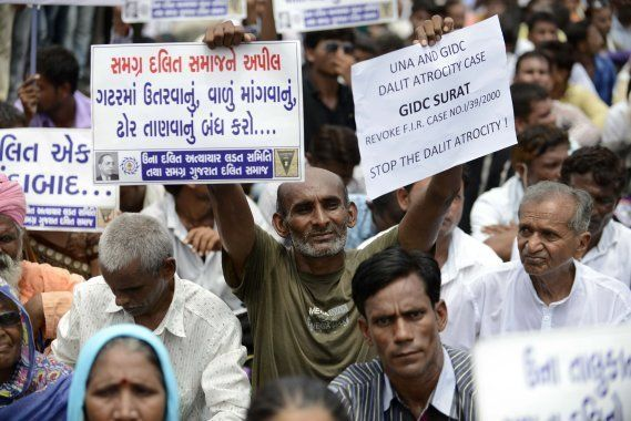 Members of the Dalit community join attend a protest rally against an attack on Dalit caste members in...