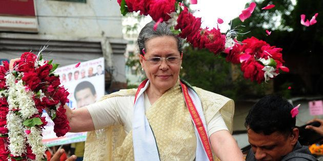 Sonia Gandhi receives floral tributes during the roadshow in Varanasi on August 2, 2016. SANJAY KANOJIA/AFP/Getty