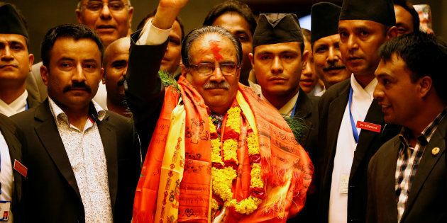 Nepal's newly elected Prime Minister Pushpa Kamal Dahal, also known as Prachanda, waves towards the media...