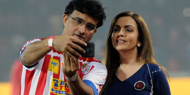 Former cricketer Sourav Ganguly clicks a selfie with Nita Ambani in Kolkata in 2015. (Photo by Prateek...