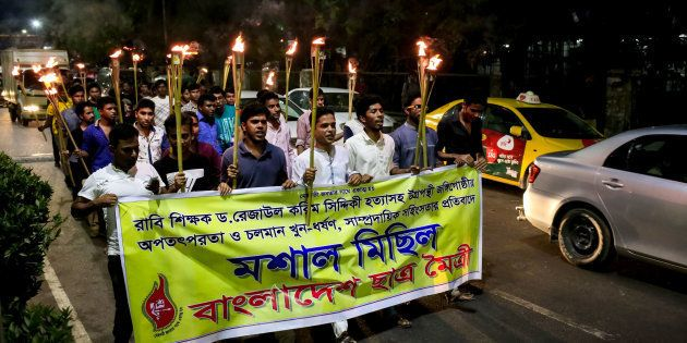 Bangladesh Student Union arranged a torch procession to protest against the killing of bloggers, writers,...