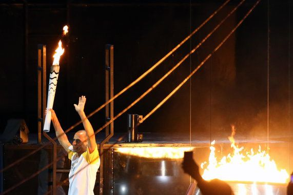 Vanderlei Cordeiro de Lima after lighting the Olympic flame during the opening ceremony. REUTERS/Ruben