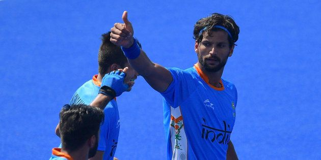 India's Rupinder Pal Singh (R) celebrates scoring a goal during the men's field hockey India vs Ireland...