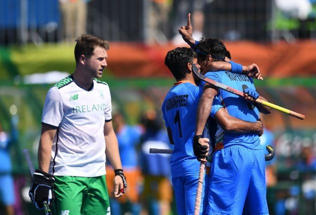 India's Rupinder Pal Singh (R) celebrates scoring a goal with teammates during the men's field hockey...