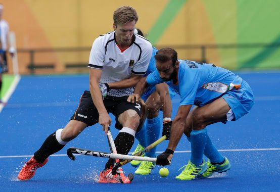 Germany's Mathias Muller, left, fights for the ball against India's Ramandeep Singh, right, during a...
