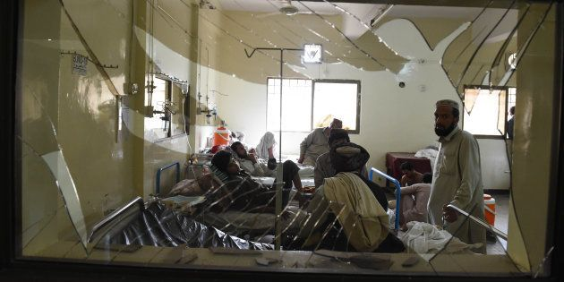 Pakistani victims injured in a suicide bombing are treated at a hospital in Quetta on 8