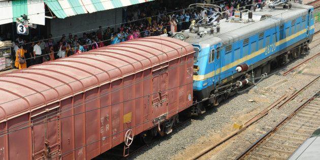 KOLKATA, INDIA SEPTEMBER 29: A goods train is passing through Dundum rail station on September 29, 2015...