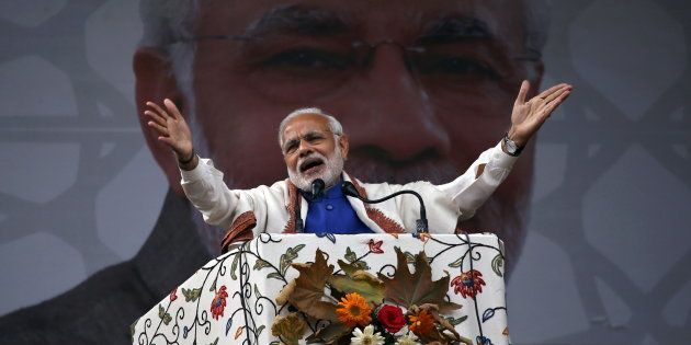 Prime Minister Narendra Modi addresses a rally in a cricket stadium in Srinagar, November 7, 2015. REUTERS/Danish