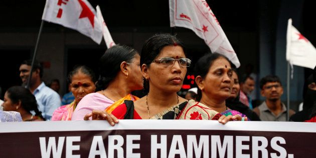 People attend a protest against what they say are attacks on India's low-caste Dalit community in Mumbai,...