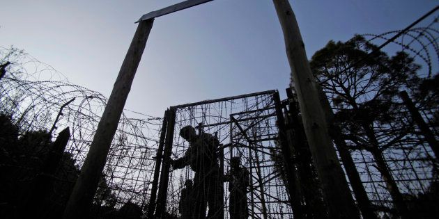 A file photo os Indian army soldiers patrolling near the India-Pakistan border fencing at the Line of...
