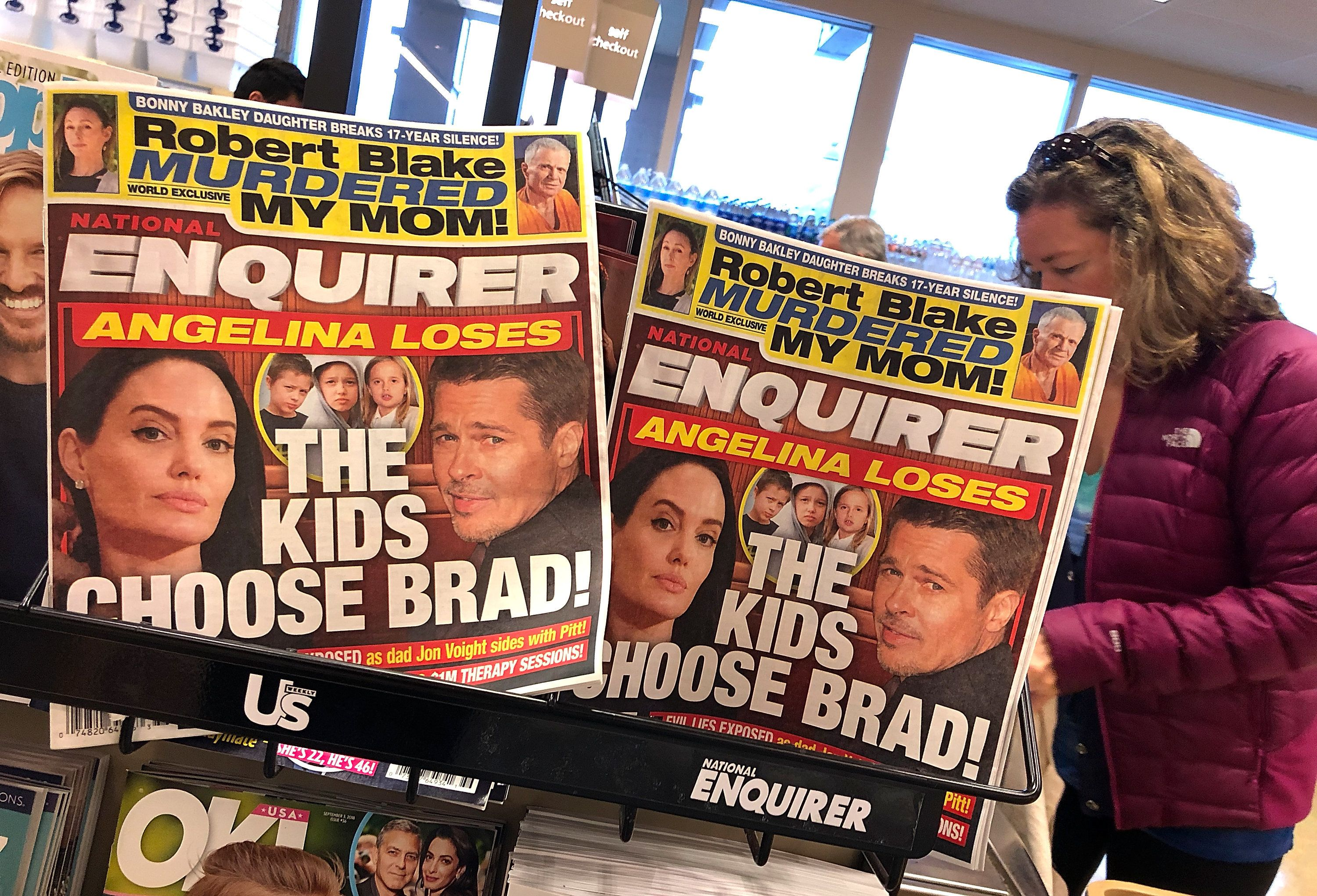 National Enquirer owner admits it buried stories for Trump