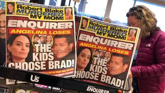 SAN ANSELMO, CA - AUGUST 24:  Copies of the National Enquirer are displayed at a grocery store on August 24, 2018 in San Anselmo, California. American Media, Inc. chairman and CEO David Pecker was granted immunity in exchange for cooperation with prosecuters working on the Michael Cohen case of hush payments made to a porn star and former Playboy playmate at the direction U.S. president Donald Trump.  (Photo by Justin Sullivan/Getty Images)