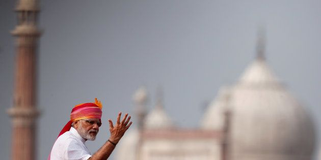 Indian Prime Minister Narendra Modi gestures as he addresses the nation from the historic Red Fort during...