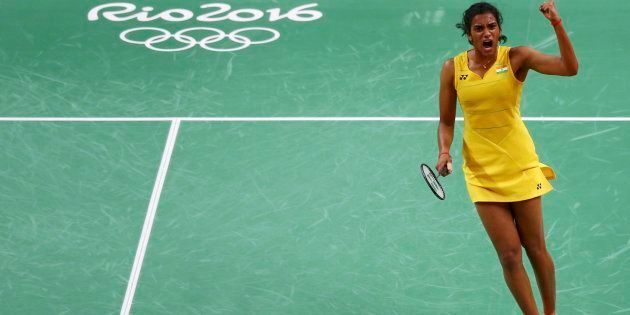 P.V. Sindhu (IND) of India celebrates winning the second set during her match against Wang Yihan (CHN)...