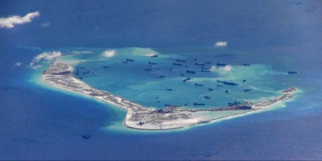 Chinese dredging vessels are purportedly seen in the waters around Mischief Reef in the disputed Spratly