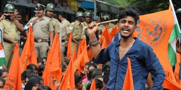 Muslim students and activists of the ABVP raise slogans against anti-national forces during a protest...