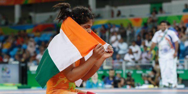 India's Sakshi Malik celebrates after winning at