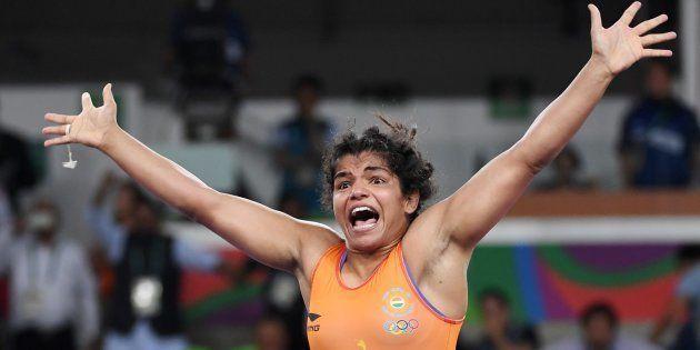 Sakshi Malik celebrates after winning against Kirghyzstan's Aisuluu Tynybekova in their women's 58kg...