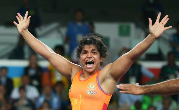 Sakshi Malik (IND) of India celebrates winning the bronze medal after her victory against Aisuluu Tynybekova...