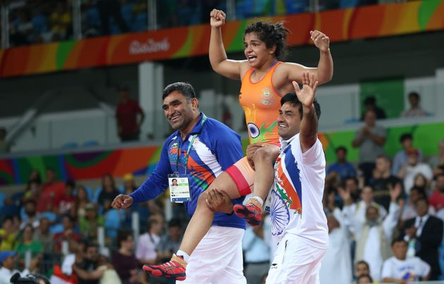 Sakshi Malik (IND) of India celebrates with her team members after winning the bronze