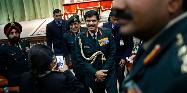 File photo of Indian Army chief General Dalbir Singh (C) leaves the venue after addressing a news conference...
