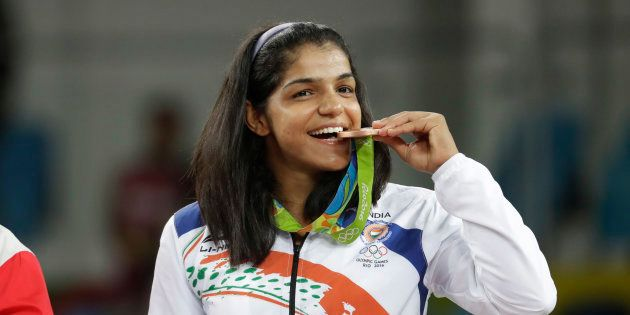 India's Sakshi Malik poses with her bronze