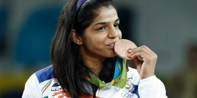 India's bronze medallist Sakshi Malik stands on the podium at the end of the women's 58kg freestyle wrestling...